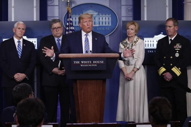President Trump takes questions from reporters Monday. Joining him at the press briefing on coronavirus are Vice President Pence; Attorney General William Barr; Dr. Deborah Birx, White House coronavirus response coordinator; and Navy Rear Adm. John Polow