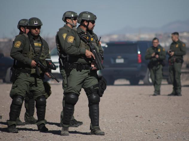 U.S. Border Patrol agents conduct a training exercise in the Anapra area, in front of the wall that divides Sunland Park, N.M., from the Mexican state of Chihuahua.