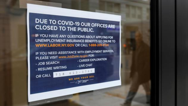 """A """"closed"""" sign is posted at the entrance of a New York State Department of Labor office in Brooklyn. With millions of people filing for unemployment benefits, state employment agencies have been overwhelmed around the country."""