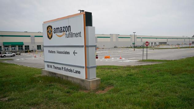 Empty parking lots surround an Amazon distribution center in Shepherdsville, Ky., that has been closed for cleaning after several employees tested positive for COVID-19.