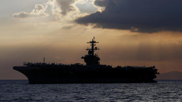 The aircraft carrier USS Theodore Roosevelt aircraft carrier anchored off Manila Bay west of Manila, Philippines, in a photo from 2018.