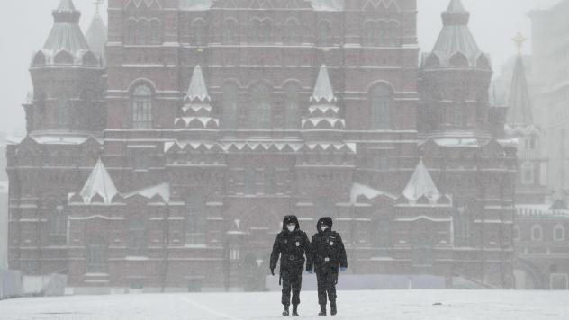 Police officers walk across an empty Red Square in Moscow on Tuesday, as the Russian capital goes into lockdown to stem the spread of the new coronavirus.