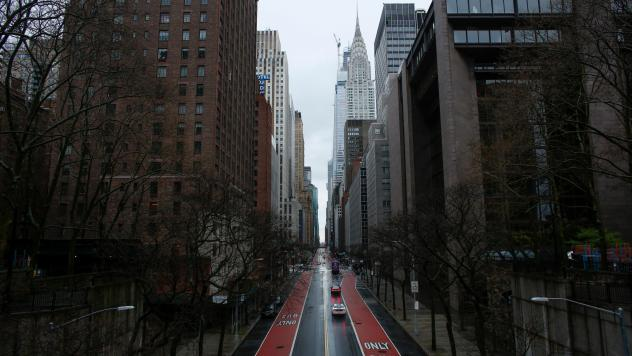 Cars cross 42th Street as rain falls on New York City. President Trump considered, and then dropped, a proposed quarantine of New York state, New Jersey and parts of Connecticut.