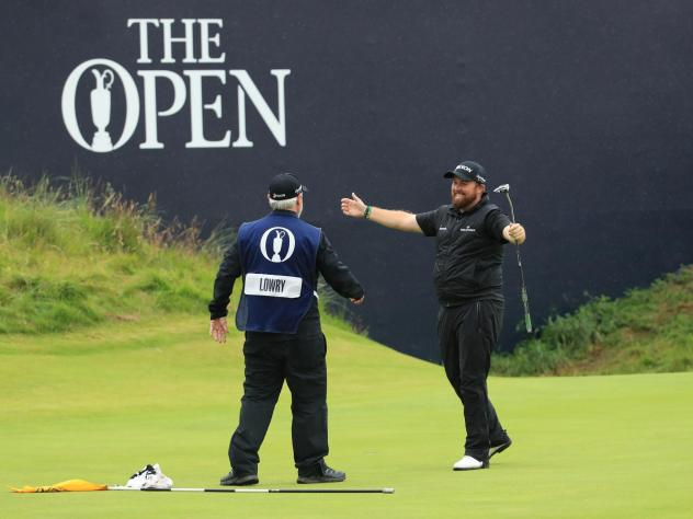 The British Open, which is golf's oldest tournament, has been canceled this year because of the coronavirus. Last year, Shane Lowry (right) celebrated winning that championship.