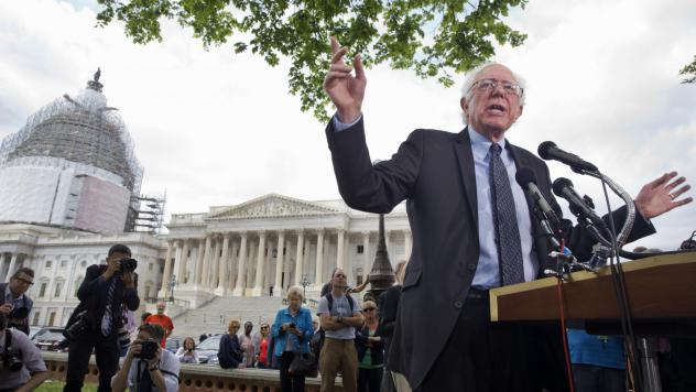 Vermont independent Sen. Bernie Sanders announces his presidential bid on April 30, 2015, on Capitol Hill in front of media members and a small group of onlookers.