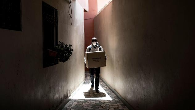 A man carries a box of protective masks to emergency workers Thursday in Dakar, the capital of Senegal. The West African country has seen relatively few confirmed cases of the coronavirus to this point — but global health officials fear that won't alwa