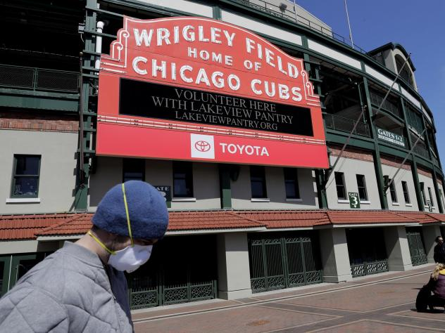 Wrigley Field's marquee displays Lakeview Pantry volunteer information in Chicago on Thursday, after MLB announced the 2020 season will be delayed because of the coronavirus.