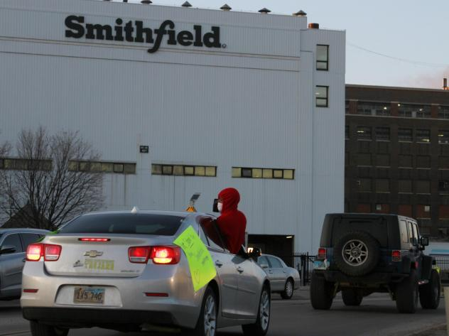 Employees and family members protest outside a Smithfield Foods processing plant in Sioux Falls, S.D., on April 9. Smithfield is being sued over its handling of the coronavirus pandemic.
