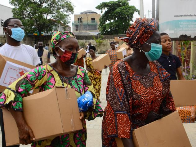 People collect emergency rations of food and essential supplies from the Red Cross Society of Nigeria in Lagos State earlier this week.