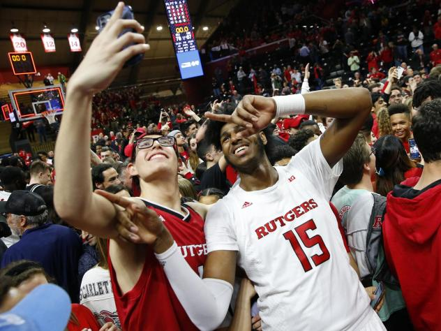 The NCAA's highest governing body supports allowing student-athletes to be compensated for third-party endorsements, along with receiving money from other avenues. Here, Rutgers center Myles Johnson celebrates with fans after defeating Maryland in March,