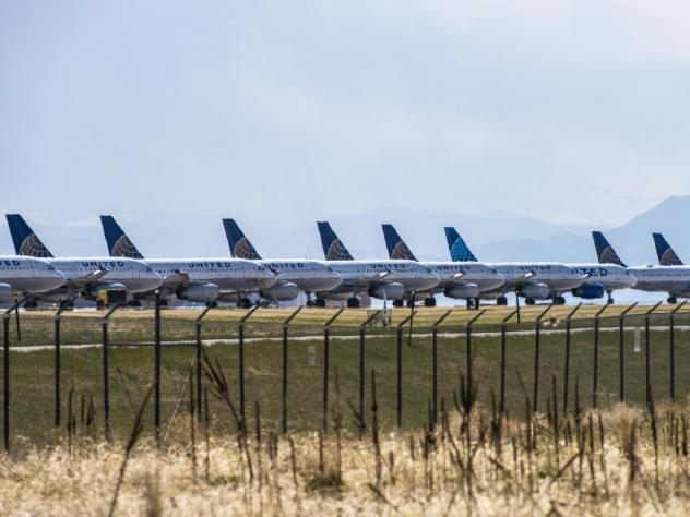 United Airlines planes sit parked on a runway at Denver International Airport on April 22, 2020 as the coronavirus pandemic slows air travel.