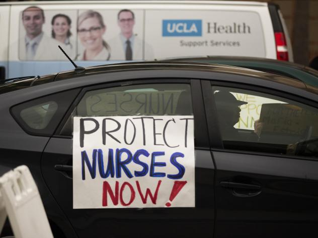 Health care workers drive by to express their support for nurses needing personal protective equipment outside the UCLA Medical Center in Santa Monica, Calif., on April 13.