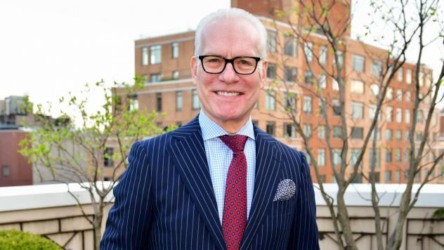 No, these are not Tim Gunn's comfy clothes — he's shown here hosting a charity cocktail reception at his Manhattan apartment in April 2018. But lately the fashion expert has been self-isolating and prioritizing comfort over style.