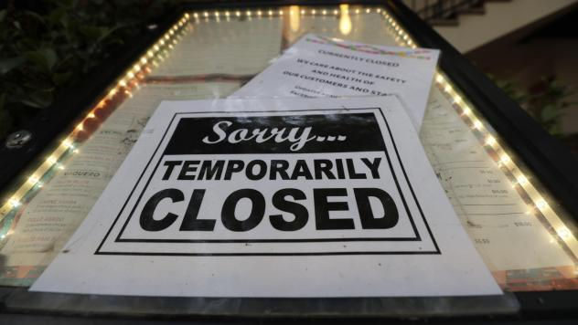 A closed sign is posted at a restaurant along the River Walk in San Antonio on April 28. Banks are reporting a little more success in getting small business owners' applications for coronavirus relief loans into government processing systems.