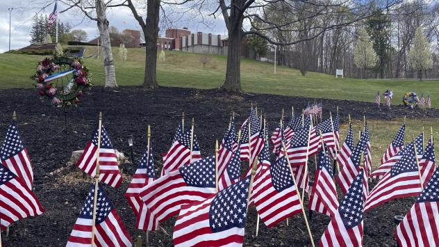 Flags and wreaths honor veterans on April 28, on the grounds of the Soldiers' Home in Holyoke, Mass., where a number of people died due to the coronavirus. While the death toll at the state-run Holyoke Soldiers' Home continues to climb, federal officials