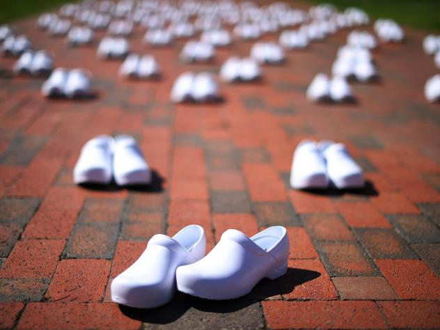 As part of a demonstration across from the White House on May 7, National Nurses United set out empty shoes for nurses who have died from COVID-19. The union is asking employers and the government to provide safe workplaces, including adequate staffing.