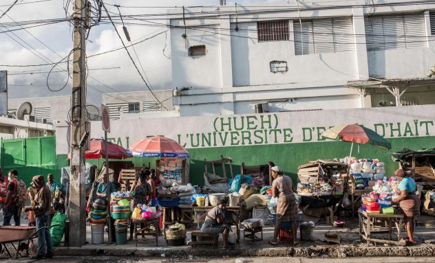 A busy market near the State Hospital in downtown Port-au-Prince. Despite a halt to air travel and other lockdown measures, Port-au-Prince looks as busy as ever, say observers.