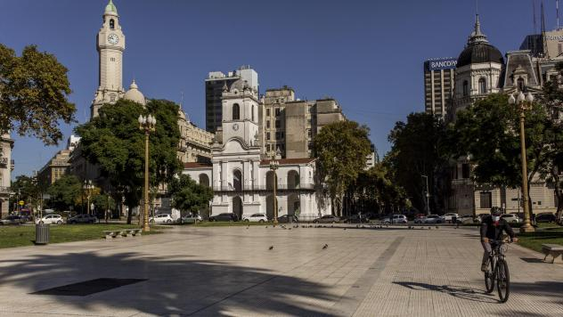 A cyclist crosses Plaza de Mayo in the center of Buenos Aires on April 30. Argentina is loosening its strict lockdown but keeping most restrictions in the capital in place.