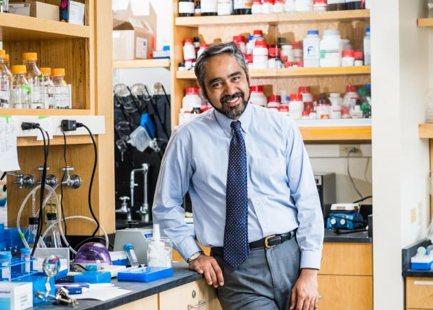 Muhammad Zaman, author of the new book <em>Biography of Resistance: The Epic Battle Between People and Pathogens</em><em>,</em> in his lab at Boston University.
