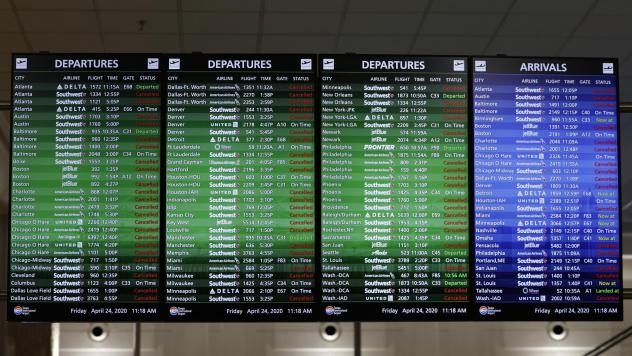 An airline arrival and departure board shows several canceled flights last month at the Tampa International Airport in Tampa, Fla.