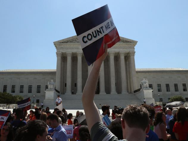 Demonstrators against the now-blocked census citizenship question gather in front of the U.S. Supreme Court in June 2019 in Washington, D.C. A federal judge in New York ruled Thursday to penalize the Trump administration for failing to disclose documents