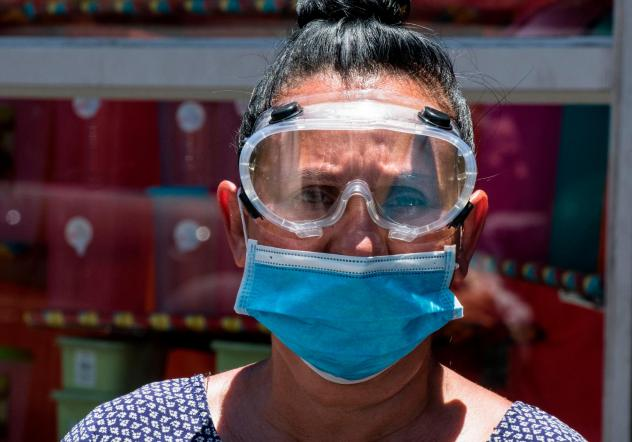 A woman wears a face mask and goggles as a preventive measure against the new coronavirus.