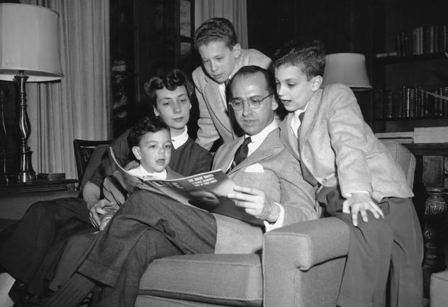 Dr. Jonas E. Salk, who discovered the polio vaccine, reads with his wife and three boys in their Ann Arbor, Mich., home on April 11, 1955. The boys were among the first vaccinated during testing. The family was photographed the night before an announceme