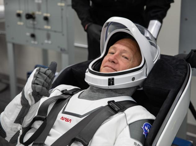 NASA astronaut Douglas Hurley rehearses putting on his SpaceX spacesuit at the Neil A. Armstrong Operations and Checkout Building Kennedy Space Center in Florida, last week.