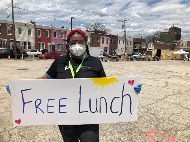 Rosalind Pichardo advertises a daily food giveaway service in the heart of Philadelphia's Kensington neighborhood, where more people die of opioid overdoses than any other area in the city.