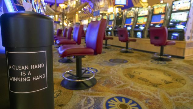 A hand sanitizing wipe station is seen next to the slot machines at the Mohegan Sun casino on May 21. Connecticut's two federally recognized tribes said they're planning to reopen parts of their casinos on June 1, despite Gov. Ned Lamont saying it's too