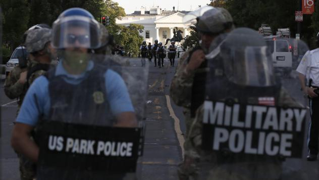 Authorities clear Lafayette Park in Washington, D.C., on Monday, while across the street at the White House, President Trump said he would send the military to U.S. cities if local officials don't end unrest.