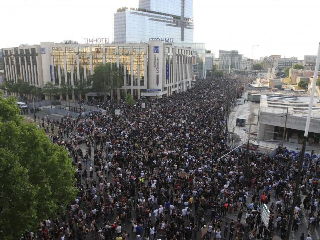 Protesters gather Tuesday in Paris. Thousands of people defied a police ban and converged on the main Paris courthouse for a demonstration to show solidarity with U.S. protesters and to denounce the death of a black man in French police custody.