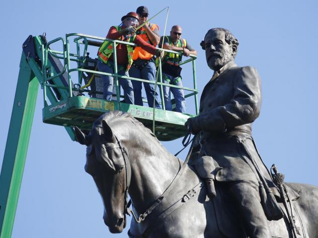 A crew from the Virginia Department of General Services takes measurements as they inspect the statue of Confederate Gen. Robert E. Lee on Monument Avenue on Monday.