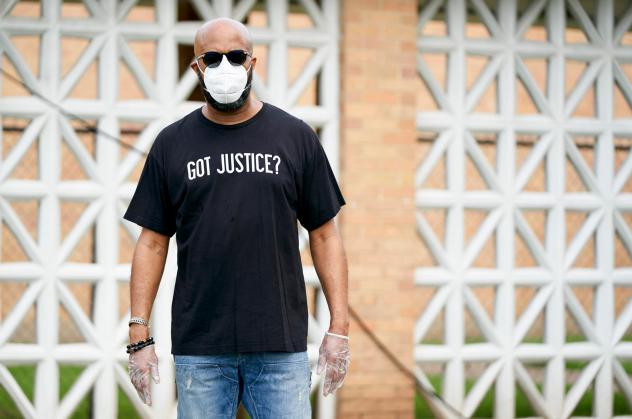 """Frederick Haynes, senior pastor of Friendship-West Baptist Church in south Dallas, poses for a portrait during Project Unity's """"Together We Test"""" coronavirus testing at a Friendship-West campus in South Dallas, Texas, on May 28, 2020."""