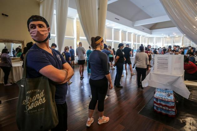Voters wait in line to cast their ballots in the state's primary election at a polling place, Tuesday, June 9, 2020, in Atlanta.