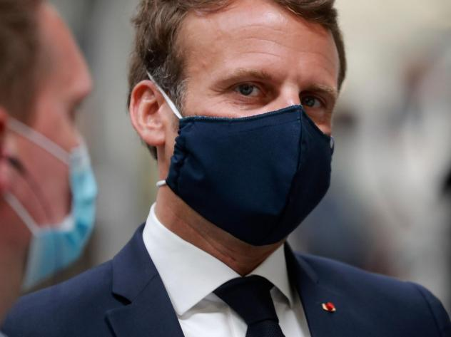 French President Emmanuel Macron, wearing a protective face mask, visits a Valeo auto parts factory in Etaples, in the north of France, late last month.