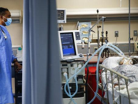 A COVID-19 patient is attached to a ventilator in April in the emergency room at St. Joseph's Medical Center in Yonkers, N.Y. A steroid treatment is showing promise in reducing mortality for patients on ventilators.