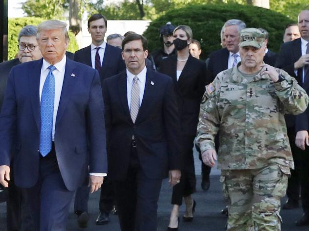 """President Trump walking from the White House to St. John's Church on June 1. Gen. Mark Milley (far right), chairman of the Joint Chiefs of Staff, was among those walking behind the president. Milley says his presence was """"a mistake"""" that he has learned f"""