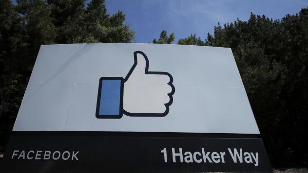 Facebook's Like logo is shown on a sign at the company's headquarters in Menlo Park, Calif.