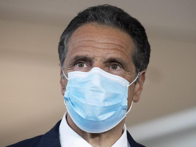 """New York Gov. Andrew Cuomo, shown here at a news conference earlier this month, said Wednesday the travel advisory would go into effect<a href=""""https://www.governor.ny.gov/news/governor-cuomo-governor-murphy-and-governor-lamont-announce-joint-incoming-tr"""