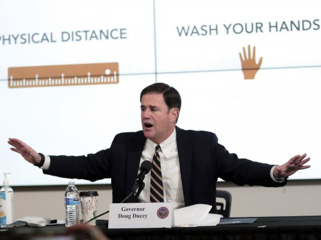 Arizona Gov. Doug Ducey updates reporters on the coronavirus pandemic during a news conference in Phoenix on Monday.