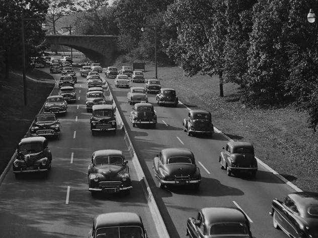 Cars on the Southern State Parkway in Nassau County, circa 1960. The urban planner Robert Moses, according to biographers, designed the road so that bridges were low enough to keep buses — which would likely be carrying poor minorities — from passing