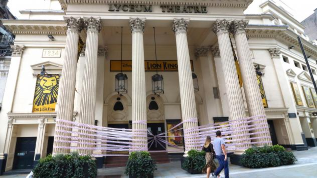 """London's Lyceum Theatre is wrapped in pink tape bearing the words """"Missing Live Theatre,"""" part of a campaign by a group of British stage designers."""