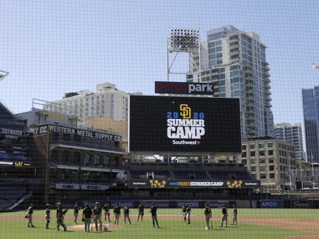 Members of the San Diego Padres meet in the infield during baseball training last week at Petco Park in San Diego. Major League Baseball is taking steps to start the 2020 season amid the coronavirus pandemic.