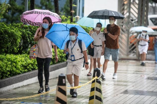 Children arrive at Hong Kong's Maryknoll Fathers' Primary School on June 8, the first day of classes since the COVID-19 outbreak.