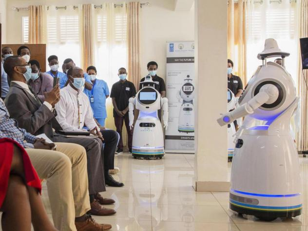 A robot introduces itself to patients in Kigali, Rwanda. The robots, used in Rwanda's treatment centers, can screen people for COVID-19 and deliver food and medication, among other tasks. The robots were donated by the United Nations Development Program