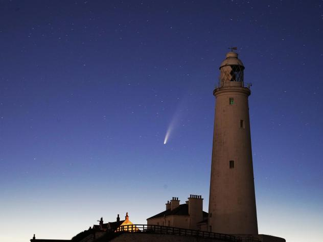 Comet Neowise passes St. Mary's Lighthouse in Whitley Bay, U.K., in the early hours of Tuesday morning.