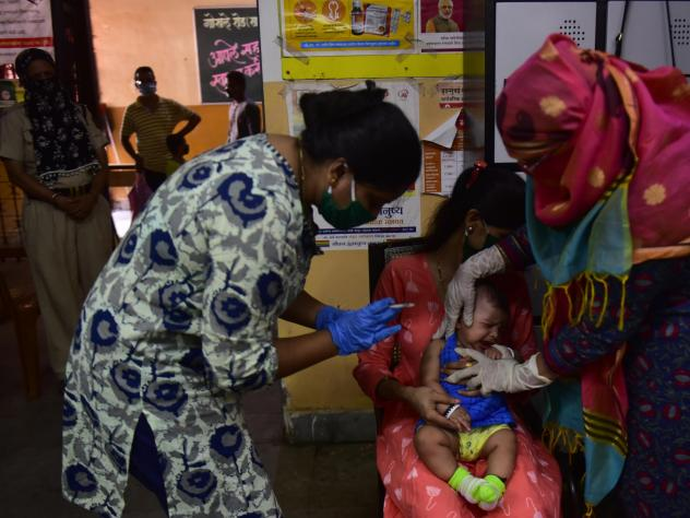 Medical staff in Mumbai, India,  last week. A U.N. report warns that the coronavirus pandemic is interfering with children getting vaccinated.