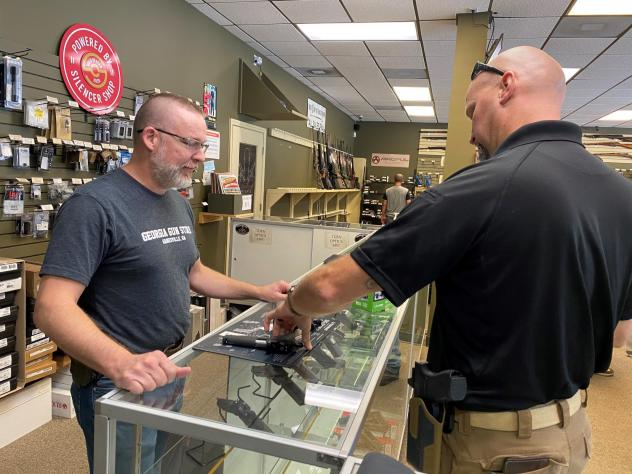 """""""Most of it is is new gun owners,"""" says Michael Weeks (left), a gun store owner in Gainesville, Ga. By one estimate, Americans have bought nearly 3 million more guns than usual since March."""
