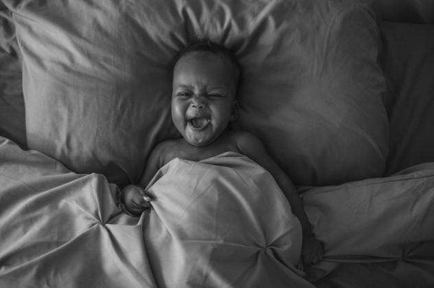 "Photographer Sarah Waiswa's image of her daughter, Ria:  ""She spends a lot of time in our bed. Babies bring the hope of goodness and light, but 2020 has been a heavy year. I am afraid about the type of world I have brought her into. I hope by the time Ri"